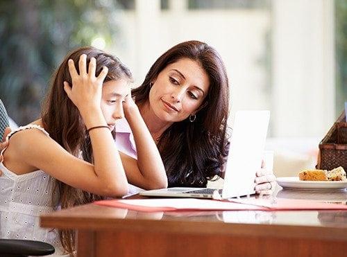 Mothers helping daughter through meditation